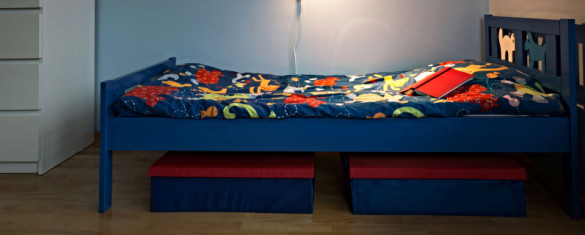 Children small bed with colorful cartoon sheet
